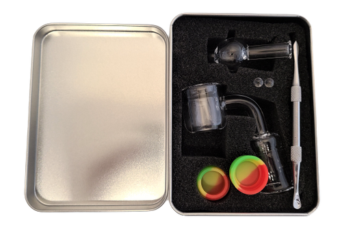 LuvBuds Thermal Banger Kit includes a 18MM female thermal banger, wax container, bubble carb cap, pearls, and dab tool in a silver Louie Luv Skull tin!
