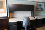 Desk with hutch and steel overhead cabinets