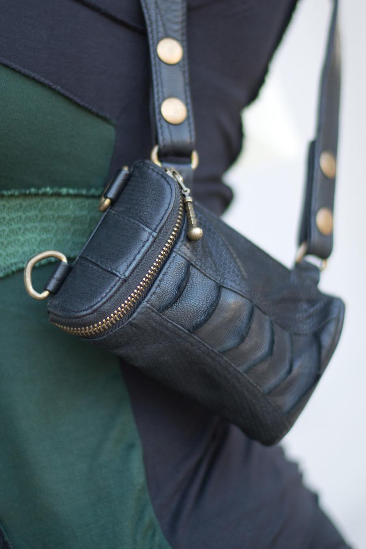 Wallet Pocket with brass details attached to Versatta Holster