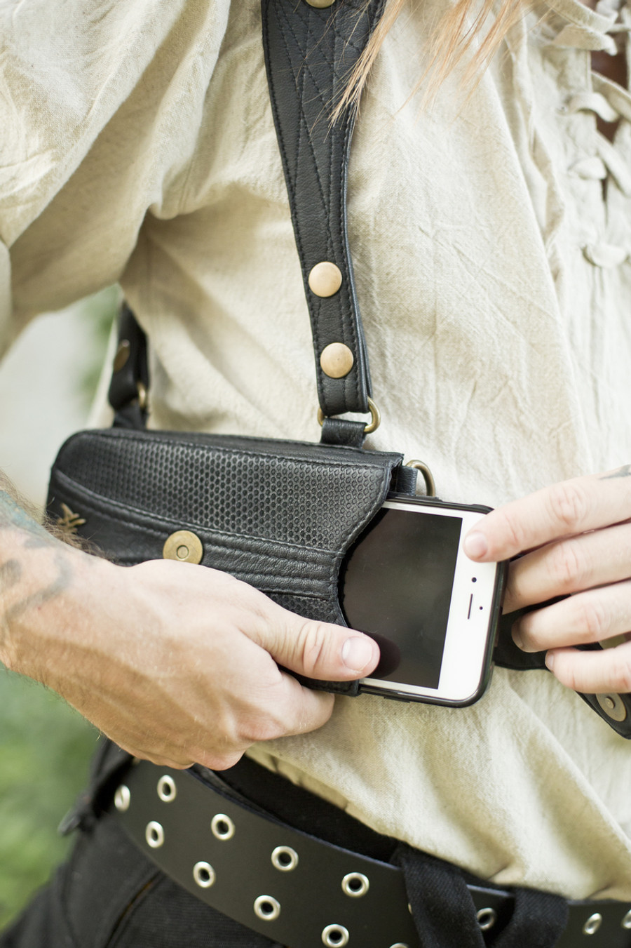 Leather Versatta Phone Pocket attached to the Holster Set.