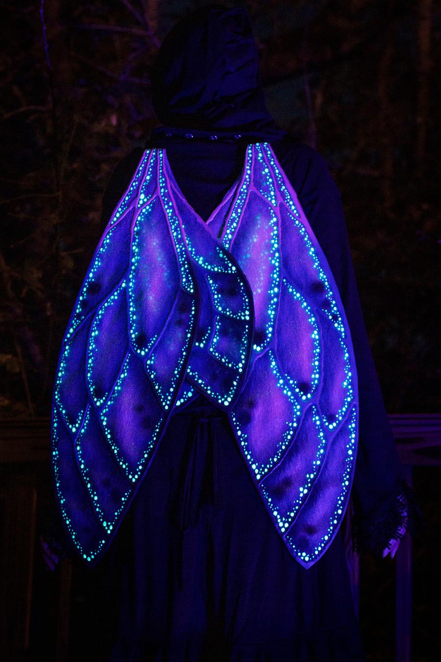 Aethervale Wings glowing underneath a blacklight