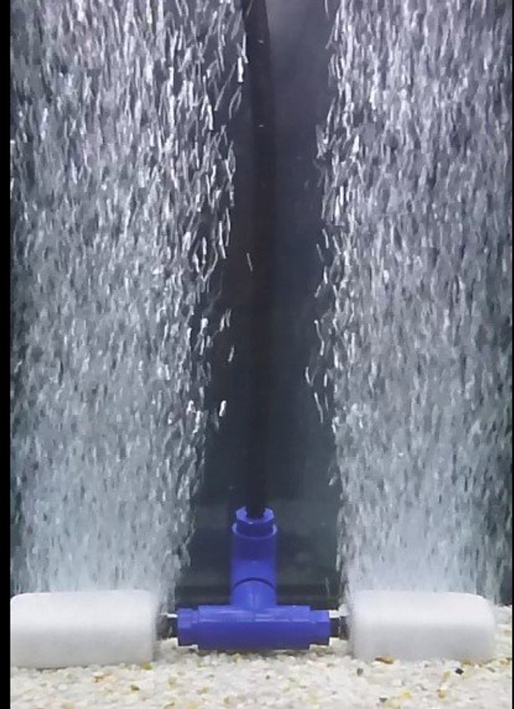 Two diffuser manifold shown in the water with medium pore diffusers attached.  Bubbles are running in the photo.