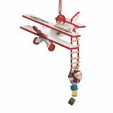 Santa Delivers from Ladder of Plane