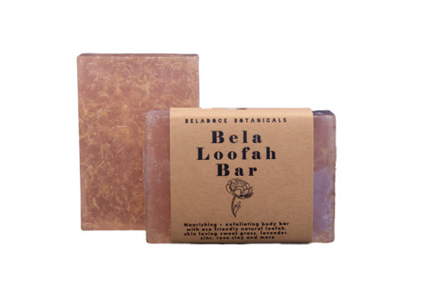The handcrafted Bela Loofah Bar nourishes and gently exfoliates the body with eco-friendly natural loofah, skin loving sweet grass, calming lavender, zinc, rose clay and more.