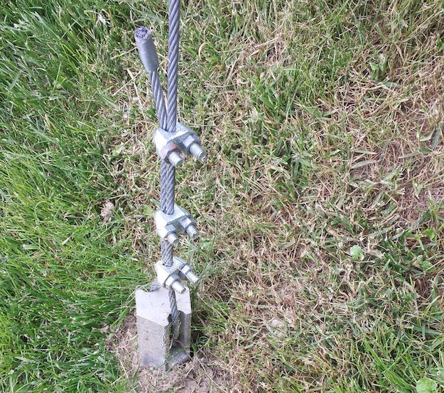 Zip line course anchored with Penetrator PE46-Guy with cable clamps