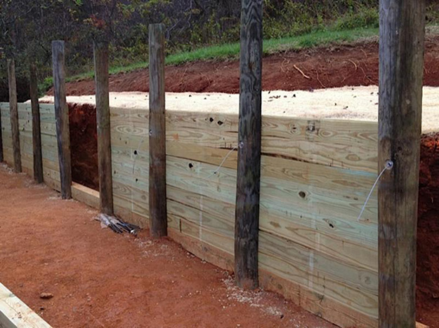 Retaining wall secured by Arrowhead anchors