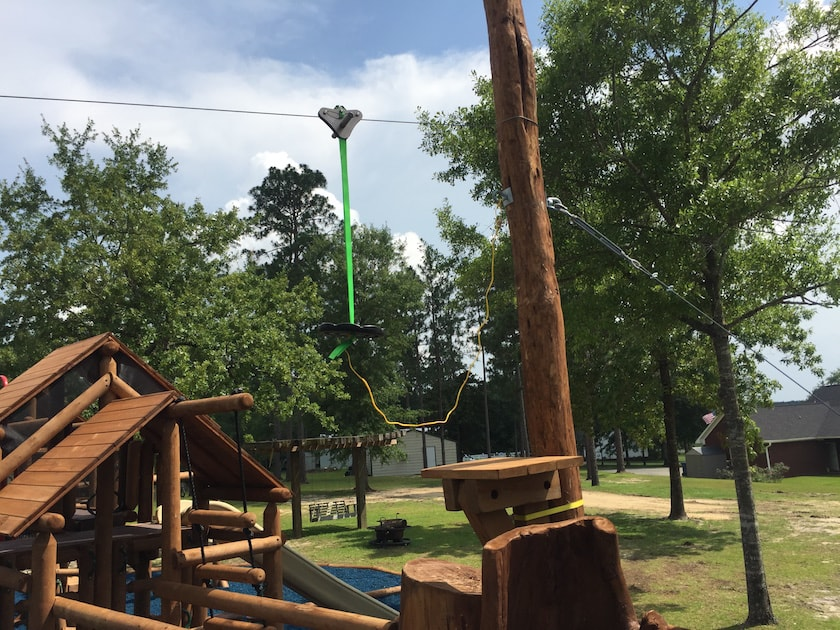 Anchor for zipline guying at playground