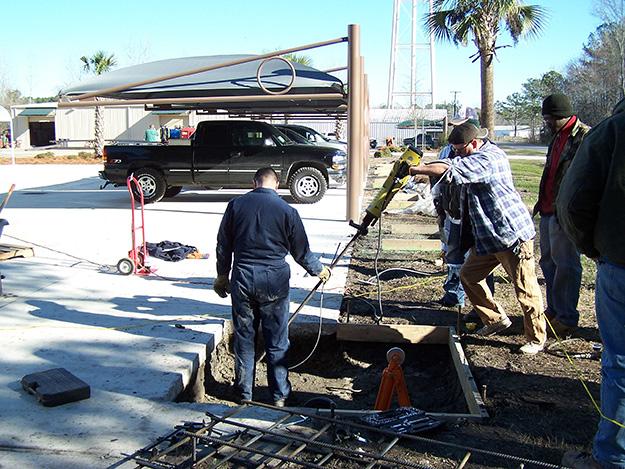Arrowhead anchor installation with jackhammer for carport