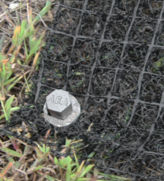 9-inch Penetrator earth anchor securing mesh mat for erosion control