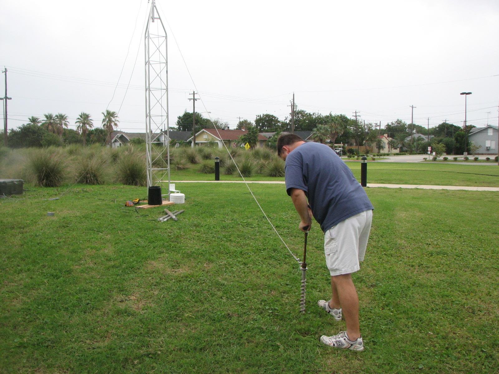 Installing three 18-inch Penetrators to secure hurricane tracker