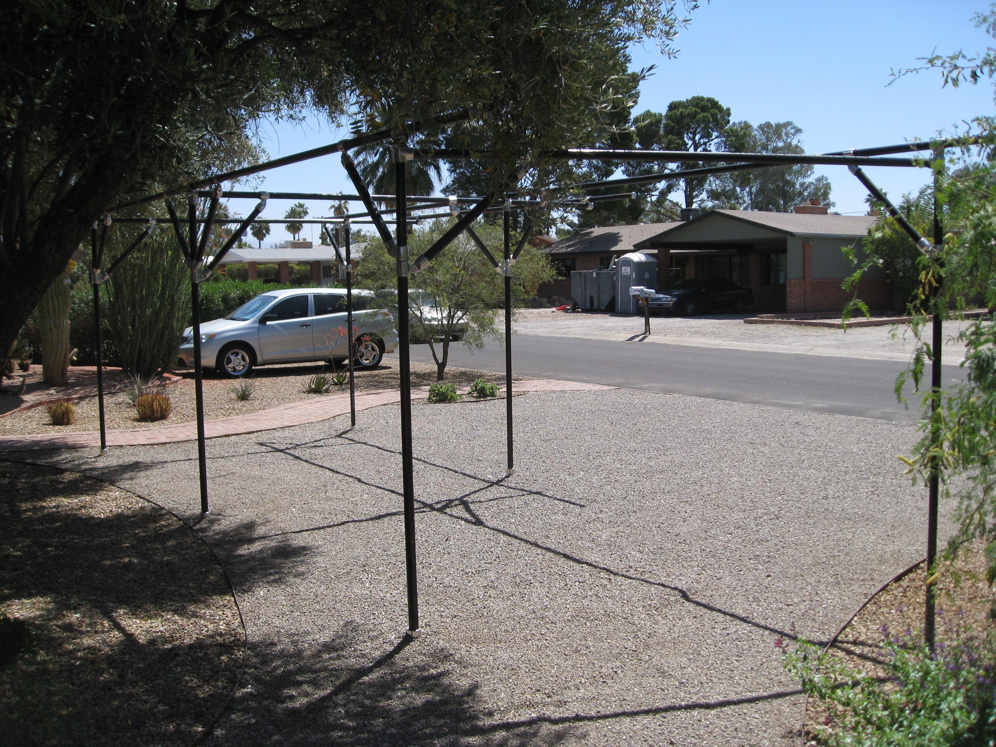 Anchoring system for carport shelter