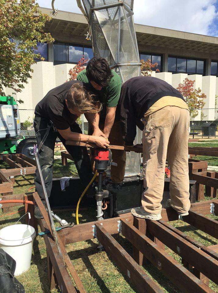 Penetrators to secure temporary outdoor art piece