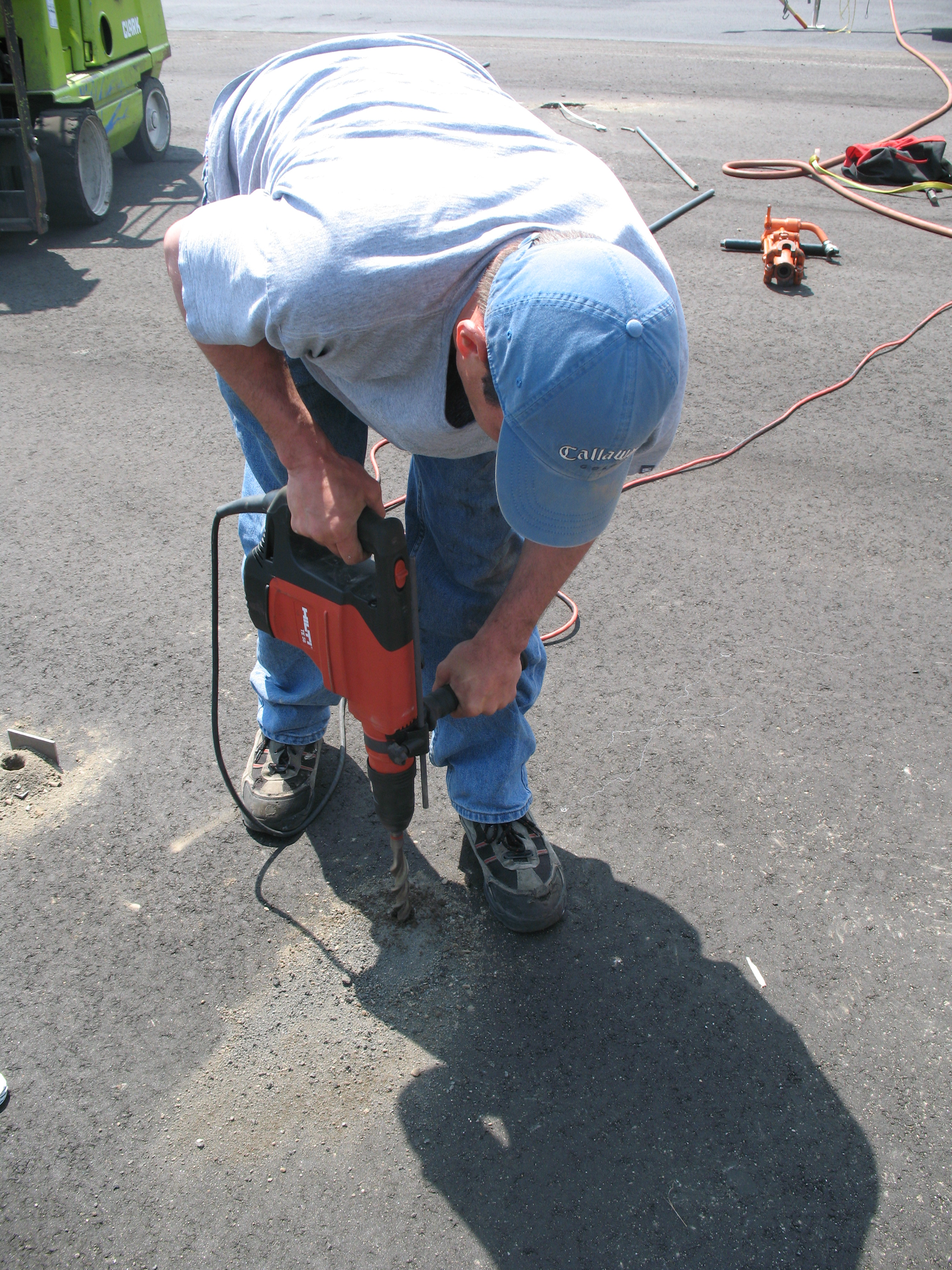 Pre-drill before installing anchors in asphalt