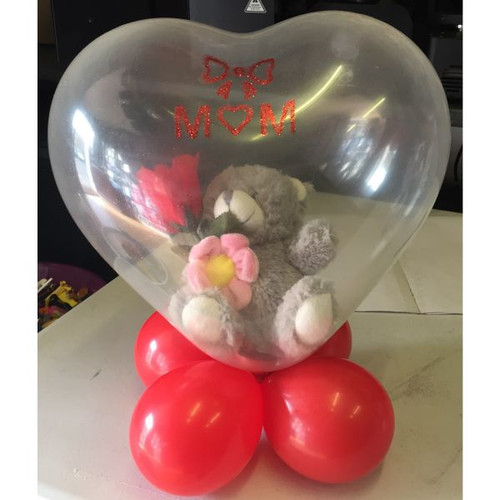 Teddy In A Heart Love Balloon   This design has a teddy with a rose inside an 15in clear heart balloon. It has various small balloons and ribbon to create a stunning gift for your loved ones.  We are able to put your own items in these balloons if requested as long as they will fit.  Great for Valentines Day, Mothers Day, Xmas, Birthdays, Anniversary's, Weddings.   These balloons are made to order. Please order at least a week before you need this item.