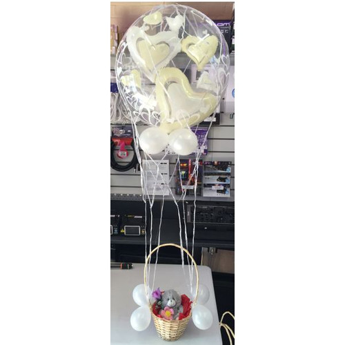 Teddy In A Basket Love Balloon   This is designed to look like a hot air balloon. It has a 22-24in balloon at the top and a teddy in a basket at the bottom. It has various small balloons and ribbon to create a stunning gift for your loved ones.  We are able to put your own items in the basket if requested as long as they will fit.   Great for Valentines Day, Mothers Day, Xmas, Birthdays, Anniversary's, Weddings.