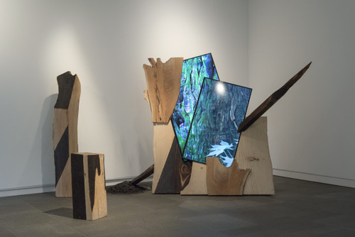 """sufferings of others _SanroksuLo by Guem MinJeong. 2019. LED media wall(40""""), (48""""),  two-channel video, wood, charcoal, 00:03:59  loop."""