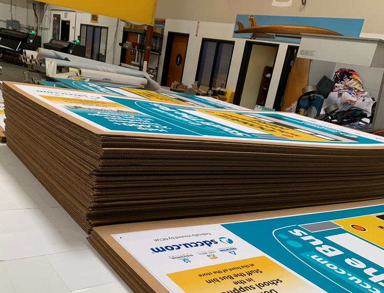 Corrugated Cardboard with a vinyl adhesive print.