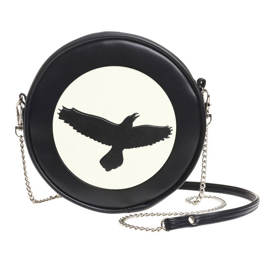 round black purse with crow silhouette against moon