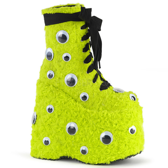 bright yellow faux fur platform boots with googly eyes