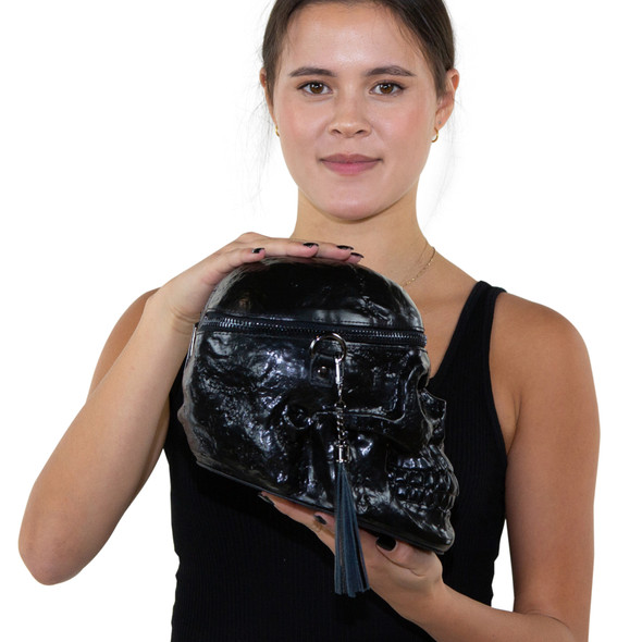 black skull purse held by young woman