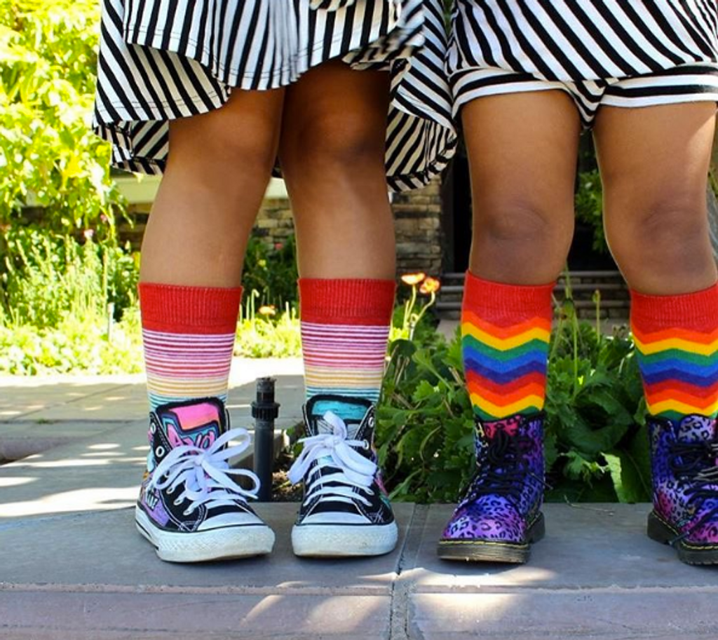 when my sister and i wearing matching toddler rainbow socks