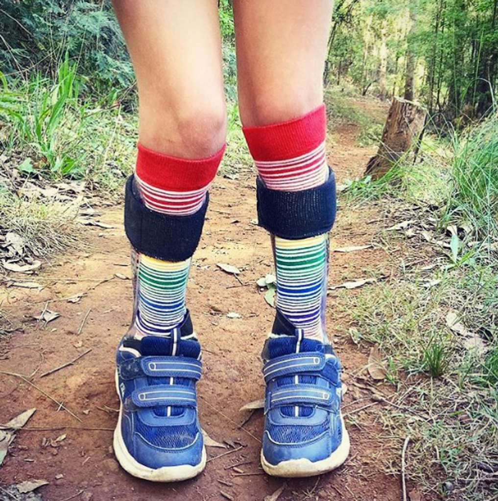 my knee high rainbow socks are perfect with my afo braces
