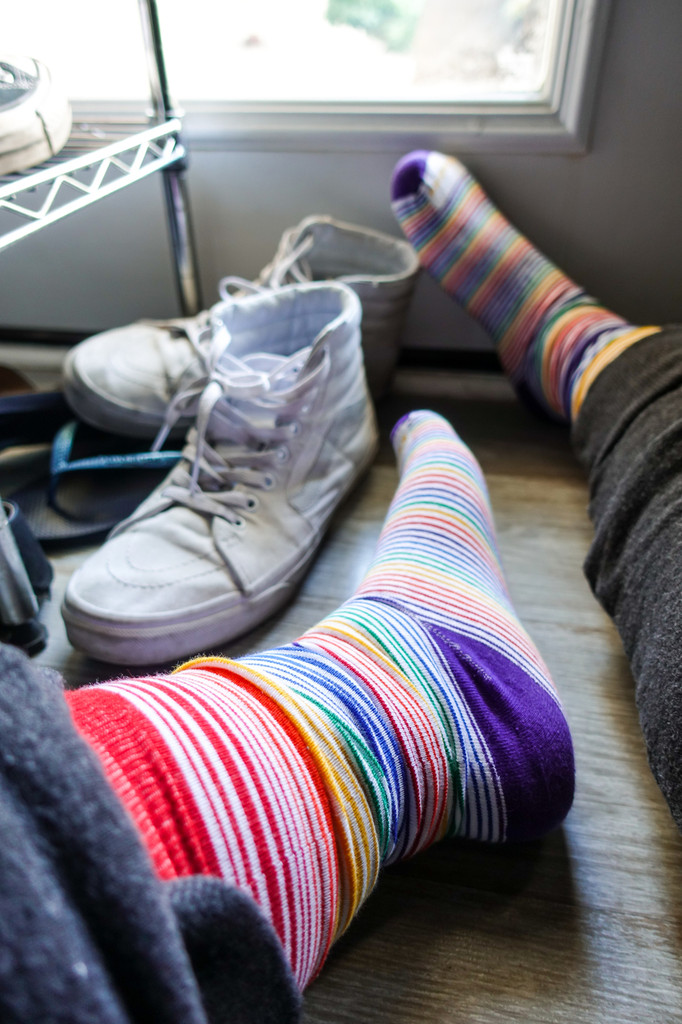 hang out and take off your shoes so you can show off your business casual pride socks