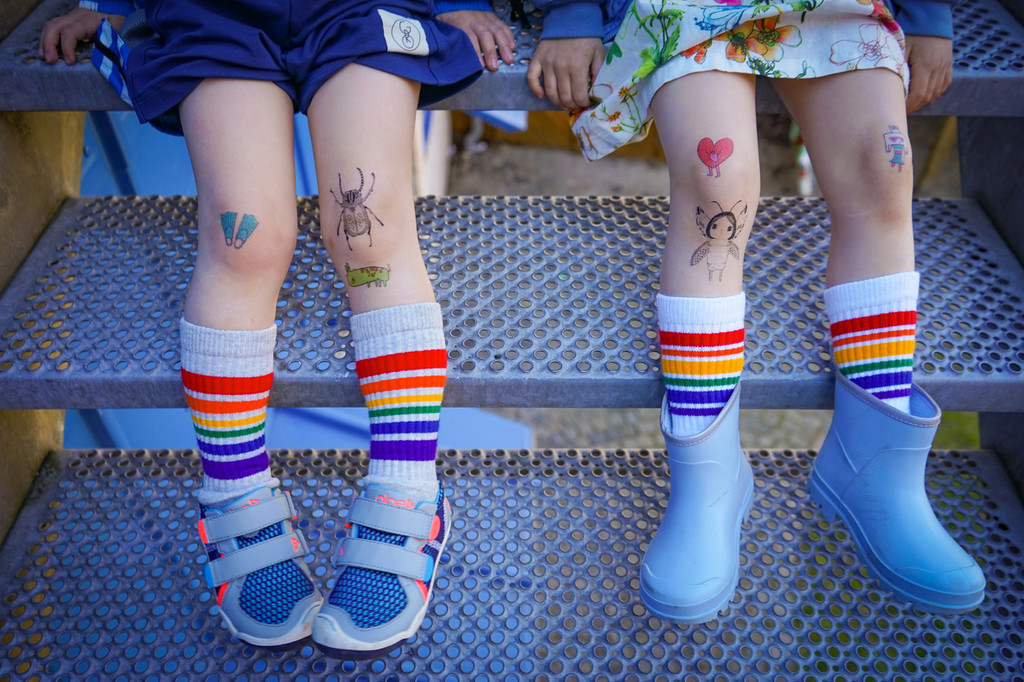 tattoos and pride socks