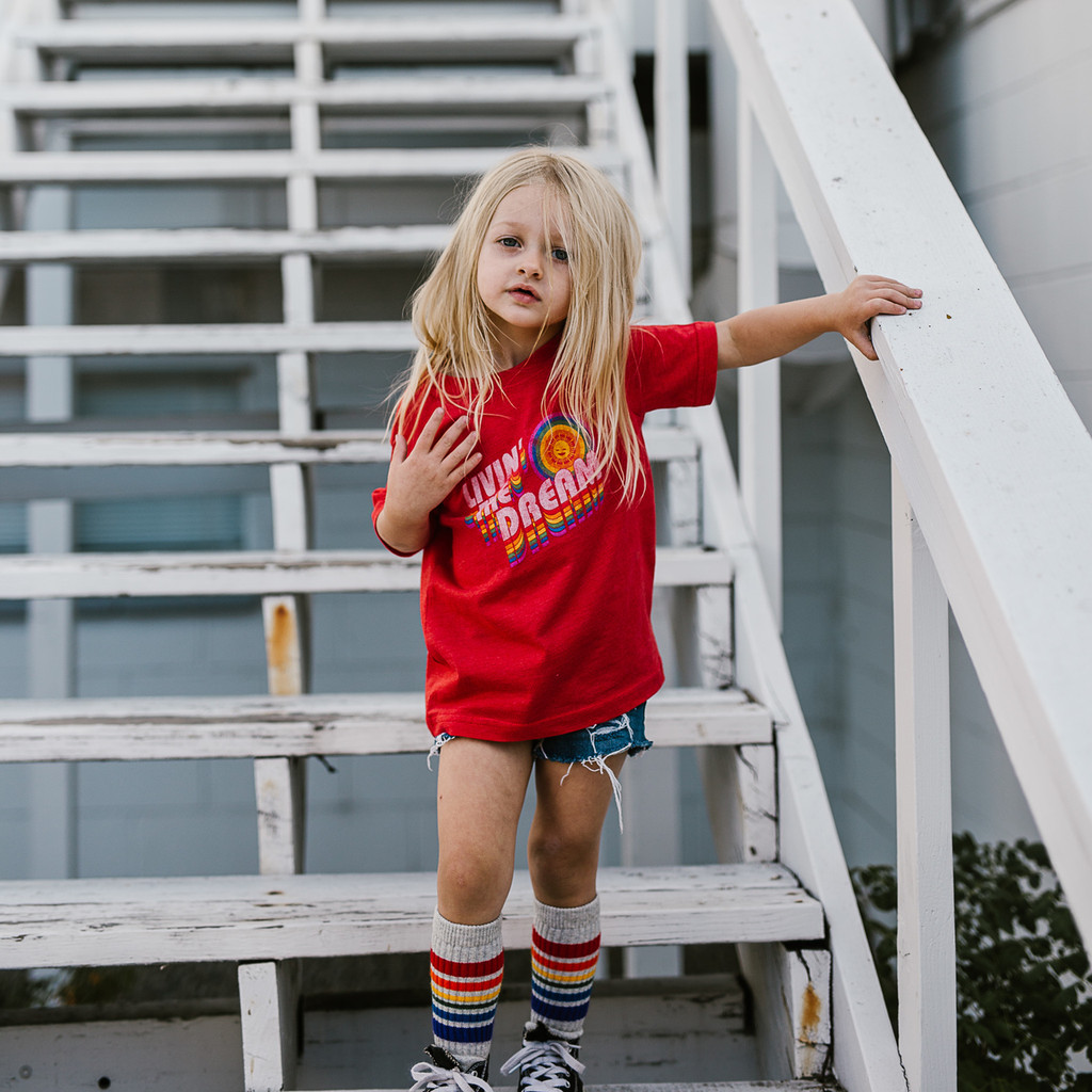Living the dream is cool to do when your outside playing in your gray tube socks