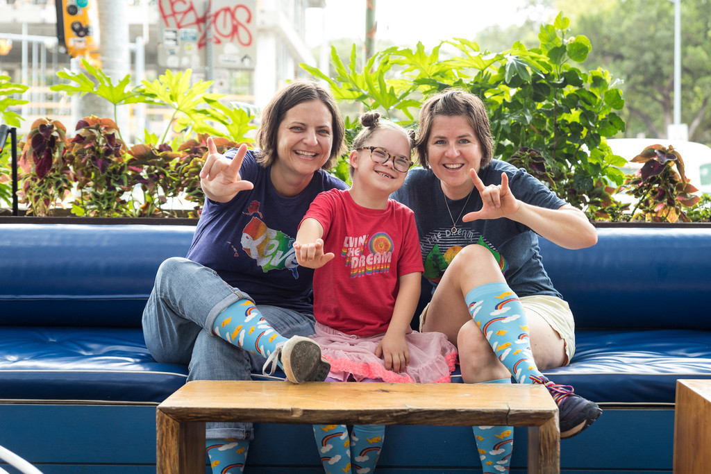 liz from rubys rainbow, ruby and rachel from pride socks hanging out showing off our socks designed to help those with Down syndrome to attend college.