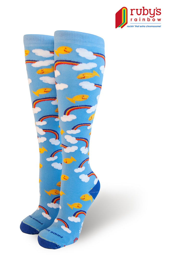 rubys rainbow and pride socks partner on a rainbow and gold fish knee high sock to benefit those with down syndrome to attend college.