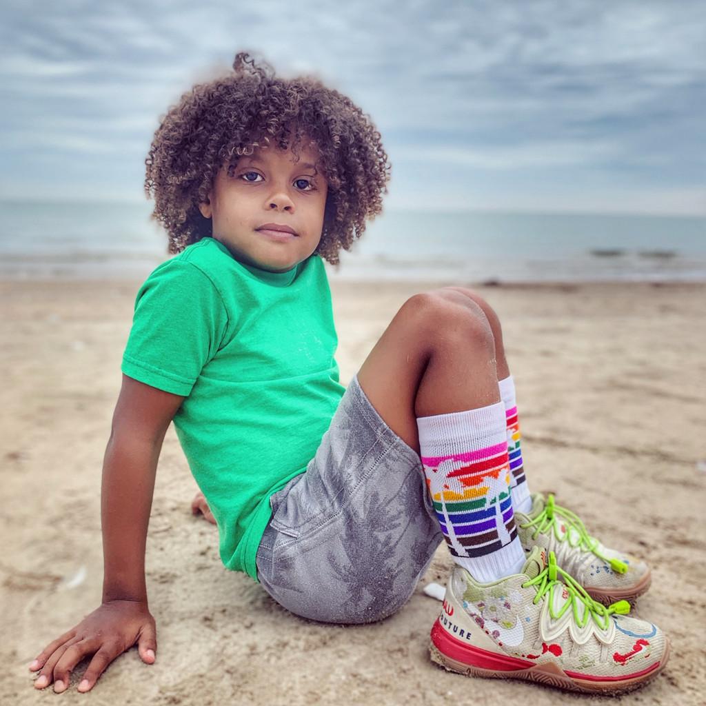 john wearing his palm tree rainbow socks from pride socks
