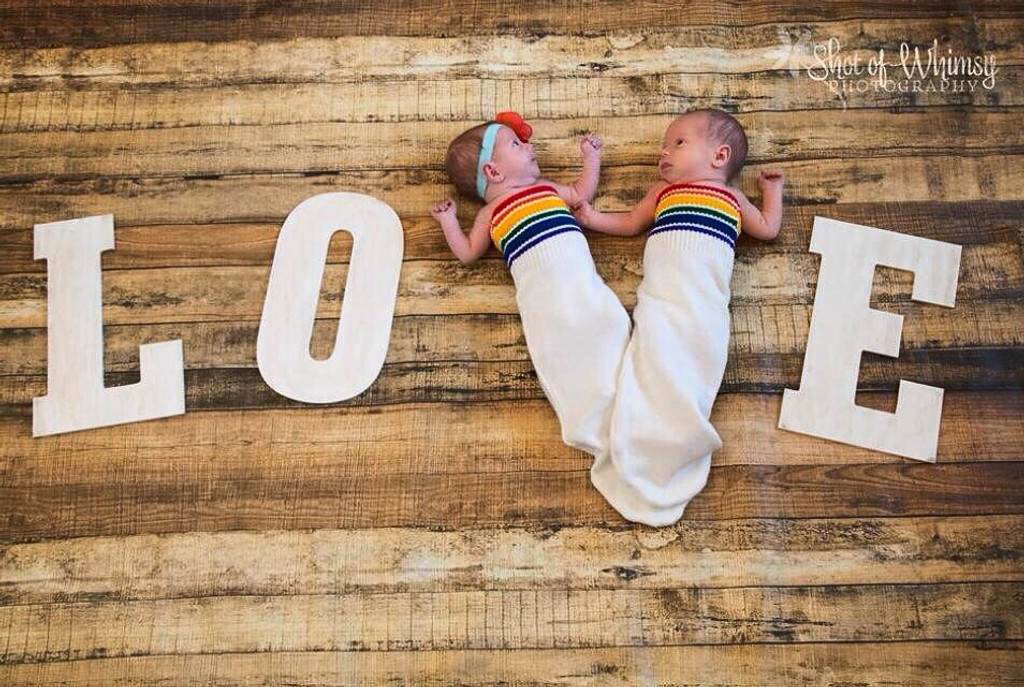 nothing more sweeter than snuggling your twins in their pride socks rainbow swaddle