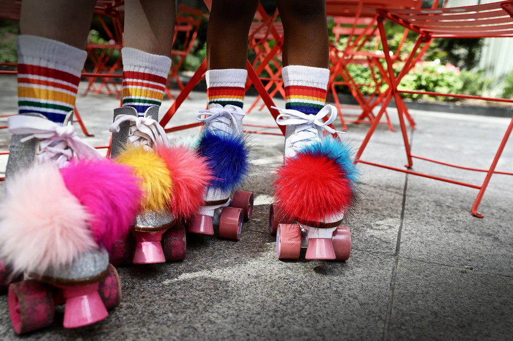 go back to the 70s with these rainbow pom poms and pride socks