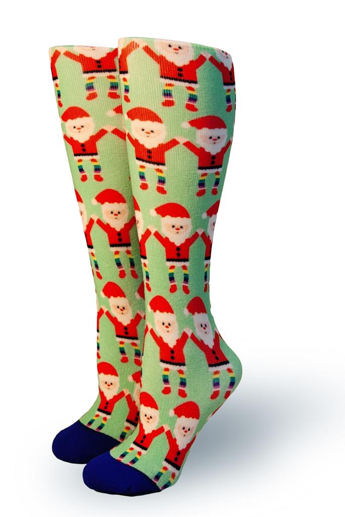 pride socks celebrate santa claus wearing his rainbow socks.  what magic will you bring this holiday season.