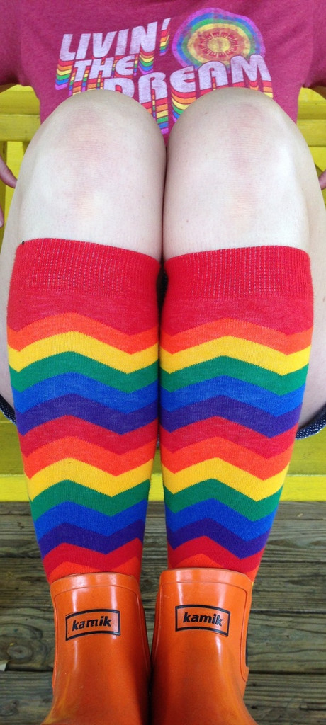 living the dream in my loud rainbow pride socks