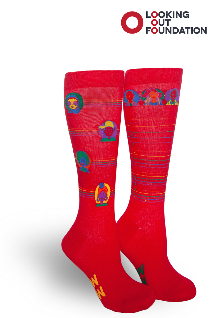 brandi carlile and pride socks collaborate to design a sock and proceeds go to looking out foundation.