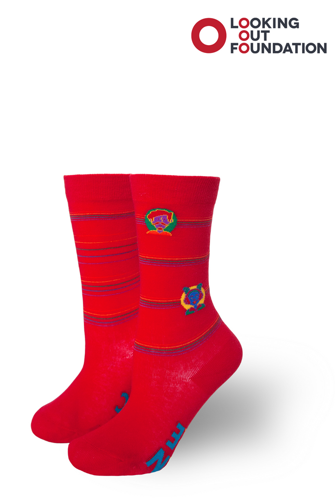 pride socks and brandi carlile collab and design a kids socks for the looking out foundation in austin texas