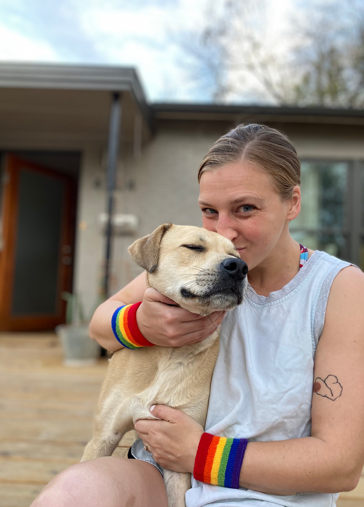 who doesn't love a dog and a lesbian in austin texas wearing their rainbow wrist bands from pride socks