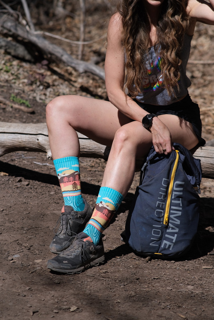 take a hike with melissa urban in the moutains and your pride socks custom for a cause socks.