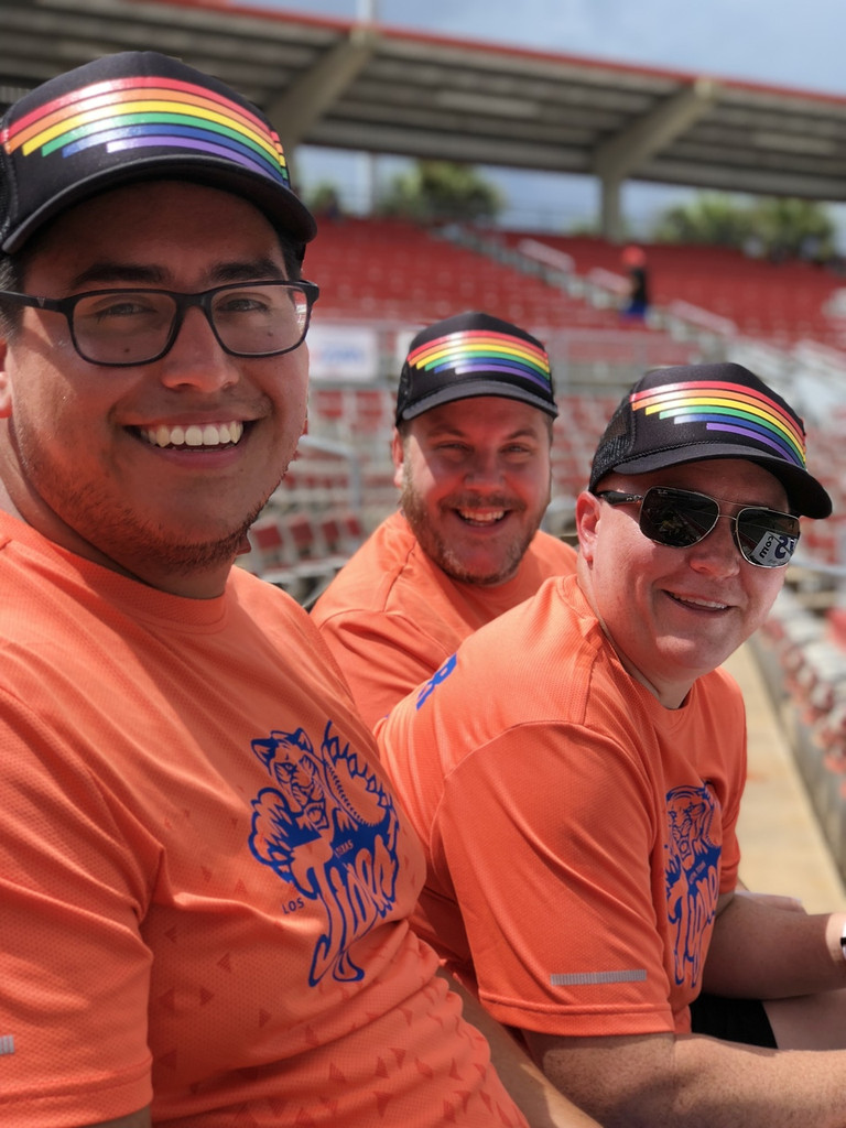 twinning it with your besties while playing softball while wearing your pride socks retro pride socks trucker hat.