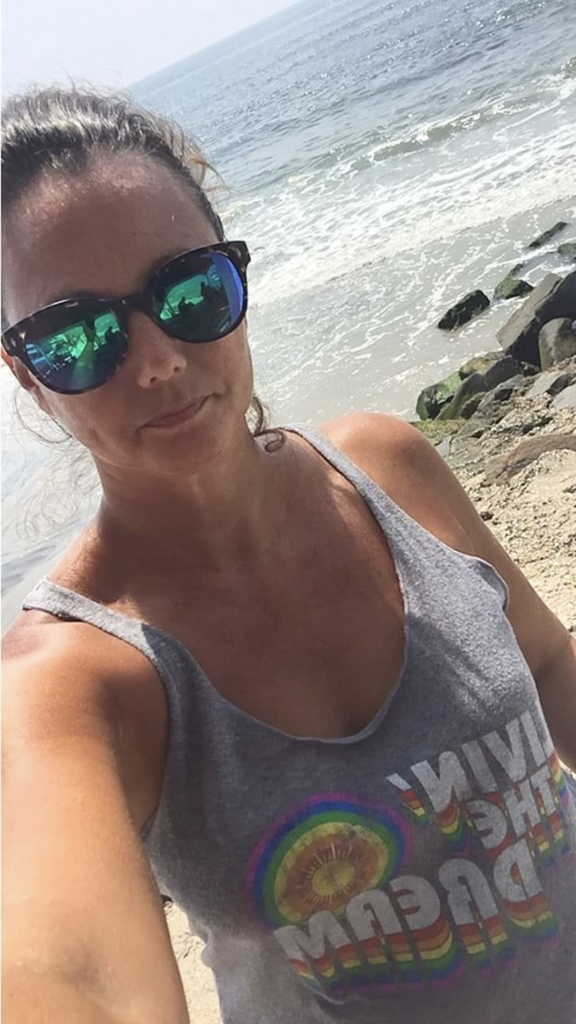 living the dream with pride socks womens road trip tank at the beach.  live the life you deserve.