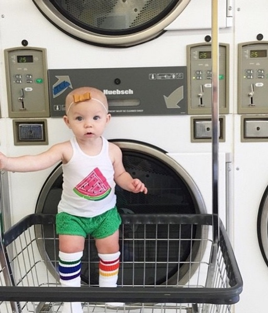 i love when my mom takes me to the laundry mat and i get to wash all my pride socks for the week.  it sure takes courage to stand in this basket though.