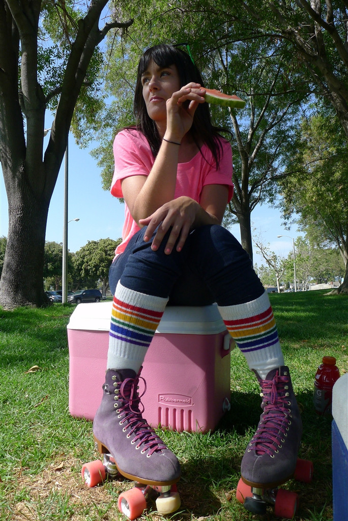 estrogen taking a break from skating and fashionably wearing her pride socks