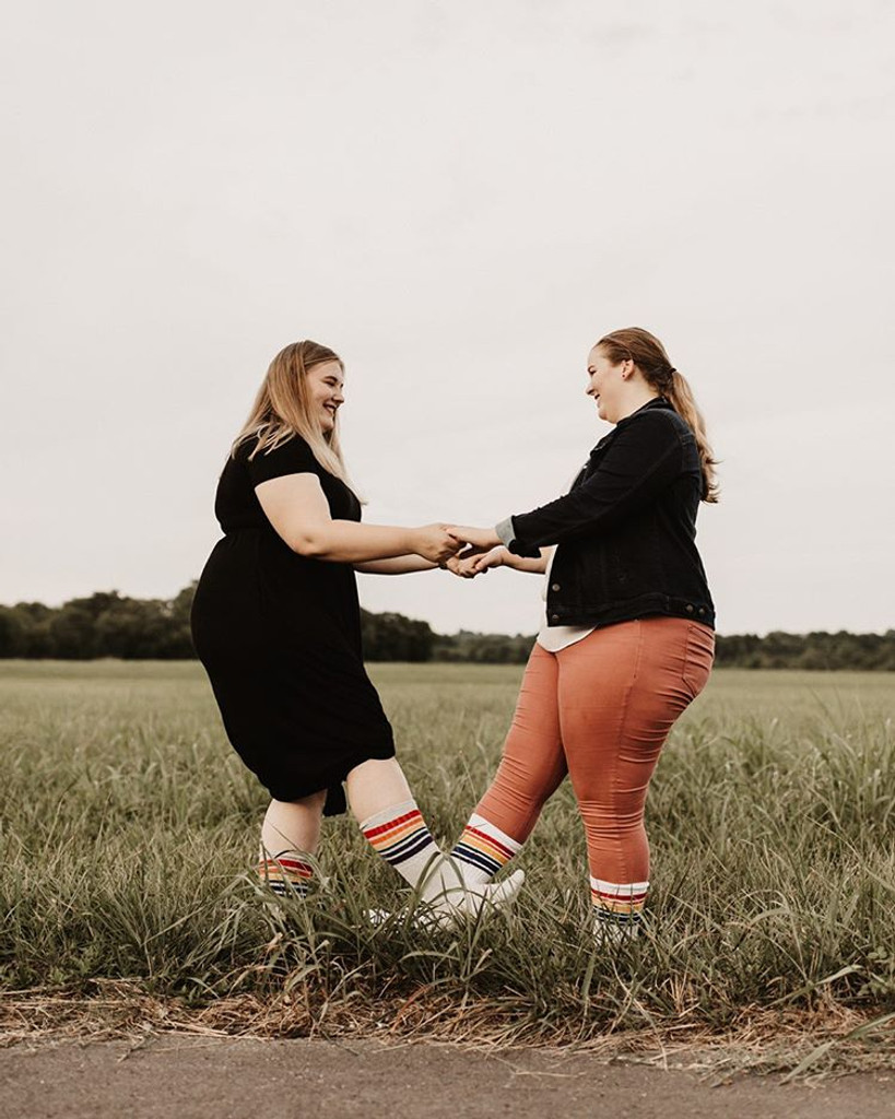 two lesbians love each other pride socks and being happy with their wedding date being planned