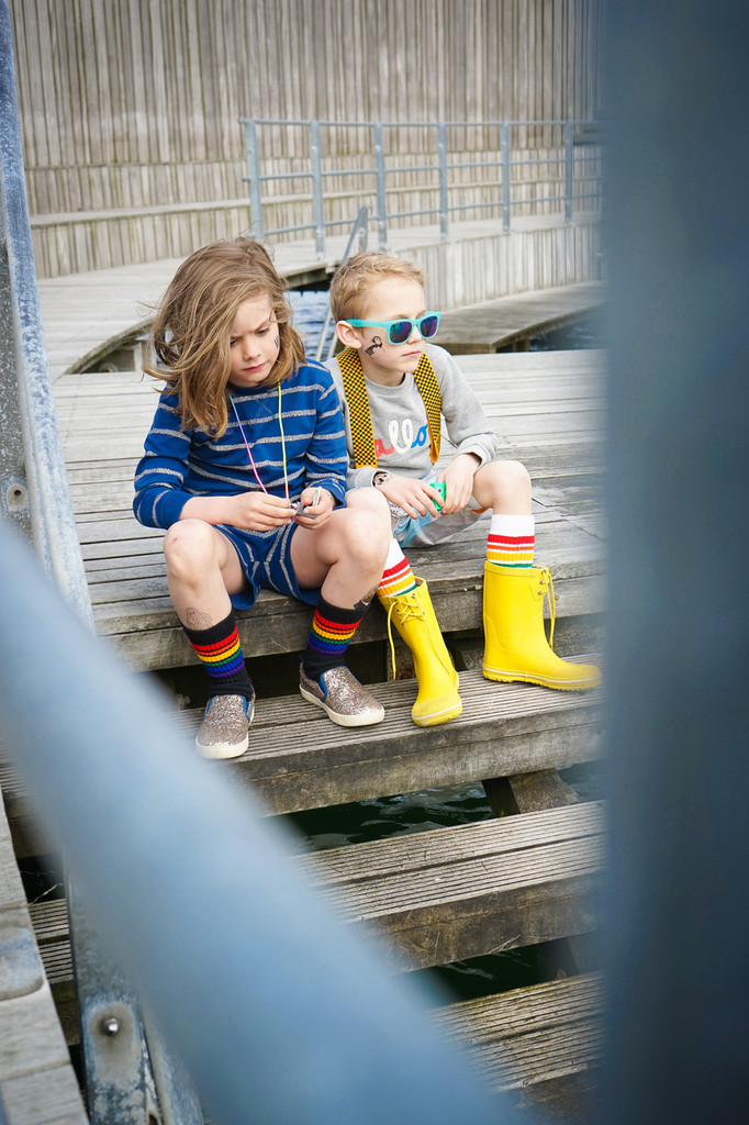 two best friends hanging out wearing their kids rainbow striped pride socks