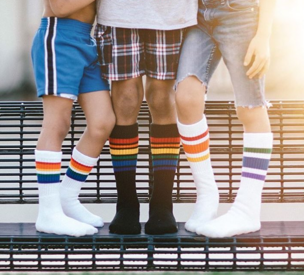 my brothers and i all wearing our rainbow tube socks.