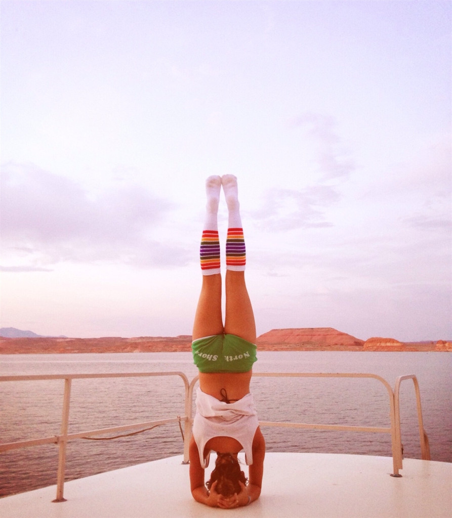 Namaste.  Feeling at peace on the water doing yoga and wearing my rainbow striped knee high socks.