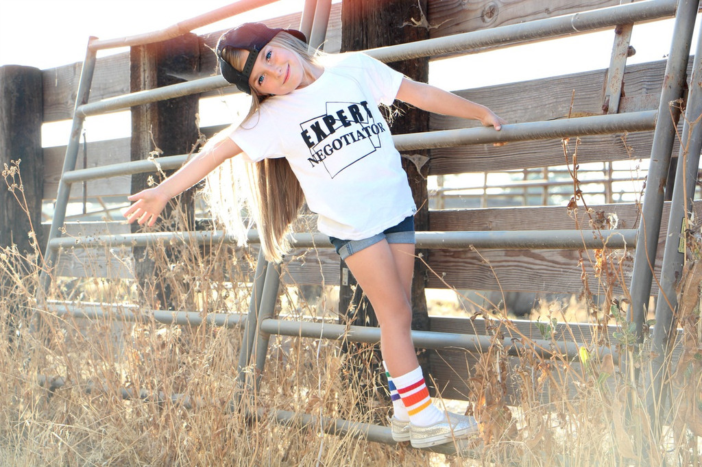 hanging out at the ranch while wearing my pride socks.
