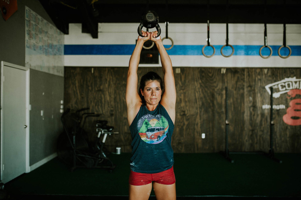 work out cross fit style while rocking your vintage muscle cut living the dream tank from pride socks.